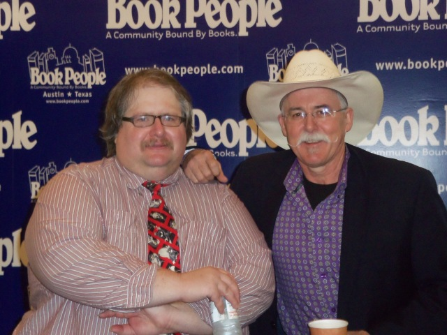 Scott Montgomery poses with Reavis Wortham at Sisters in Crime: Heart of Texas Chapter's all-day crime fiction workshop co-produced with BookPeople.